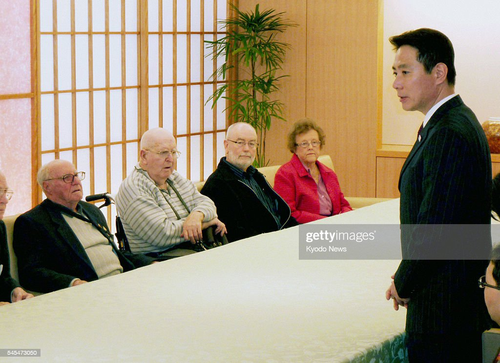 TOKYO Japan Japanese Foreign Minister Seiji Maehara apologizes to five former Australian prisoners of war and their families in Tokyo on March 3 over...