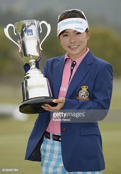 MIYAZAKI Japan Japanese golfer Natsuka Hori holds the victor's trophy at UMK Country Club in Miyazaki Prefecture on March 31 after winning the Axa...