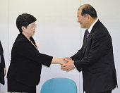 TOKYO Japan Japanese health minister Ritsuo Hosokawa and Mieko Taniguchi the leader of plaintiffs in damages suits brought against the state over...