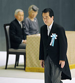 TOKYO Japan Japanese Prime Minister Naoto Kan heads for a stage to read an address at an annual war memorial ceremony at Nippon Budokan hall in...