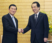 TOKYO Japan Japanese Prime Minister Naoto Kan shakes hands with Truong Tan Sang a permanent member of the secretariat of the Vietnamese Communist...