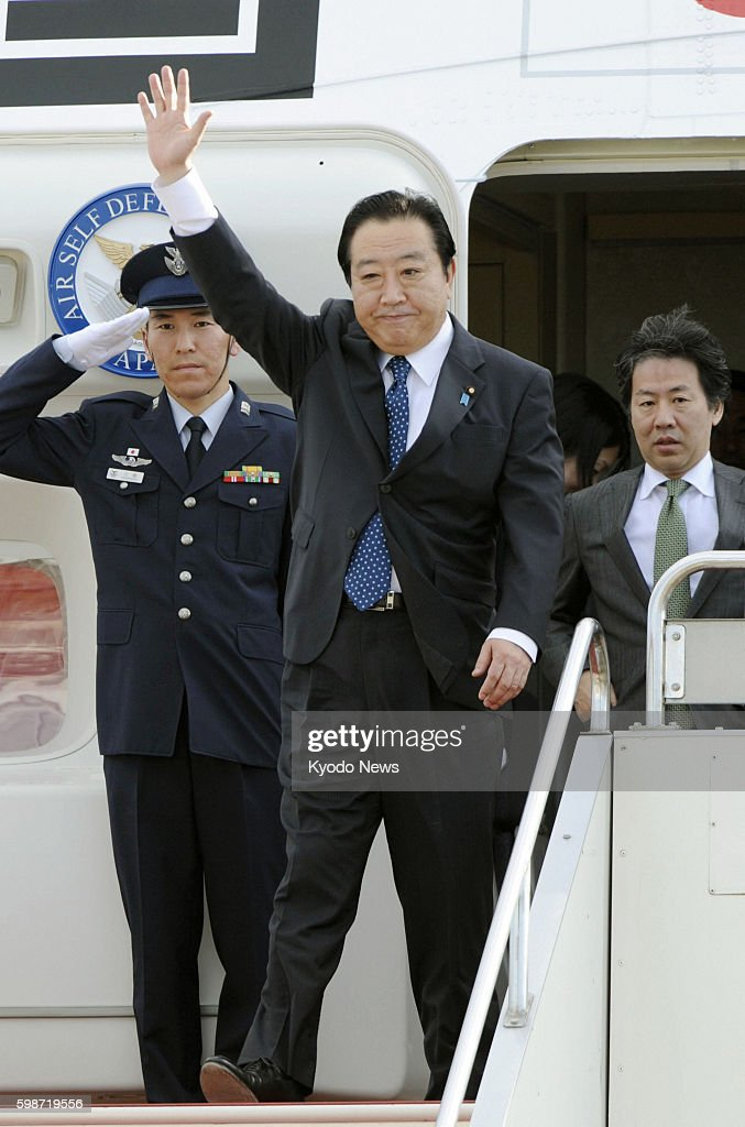 TOKYO Japan Japanese Prime Minister Yoshihiko Noda arrives at Tokyo's Haneda airport from Los Cabos Mexico on June 20 2012 In the Mexican resort Noda...