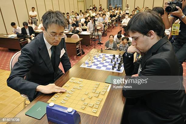 KOBE Japan Japanese shogi master Yoshiharu Habu and French chess master Maxime VachierLagrave play shogi and chess games simultaneously during an...