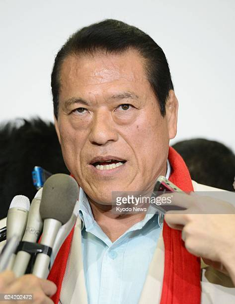 TOKYO Japan Japanese wrestlerturnedlawmaker Antonio Inoki answers reporters' questions upon arriving at Tokyo's Haneda airport on July 30 from a...