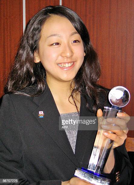 Japan's 15yearold Mao Asada smiles as she receives the trophy of 2005 Japanese Athlete of the Year Award presented from the Foreign Sportswriters...