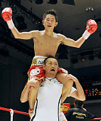 TOKYO Japan Japan's Kazuto Ioka WBC minimumweight champion celebrates on shoulders of his father who is his trainer after winning his first title...