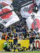 SAITAMA Japan Japan's Keisuke Honda and Makoto Hasebe respond to cheers from supporters after Japan's 30 victory against Oman in the final qualifying...