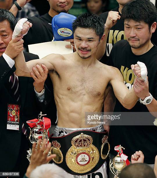 TOKYO Japan Japan's Kohei Kono holds up his fists after reclaiming the vacant WBA super flyweight title with a knockout win over Thai top ranker...