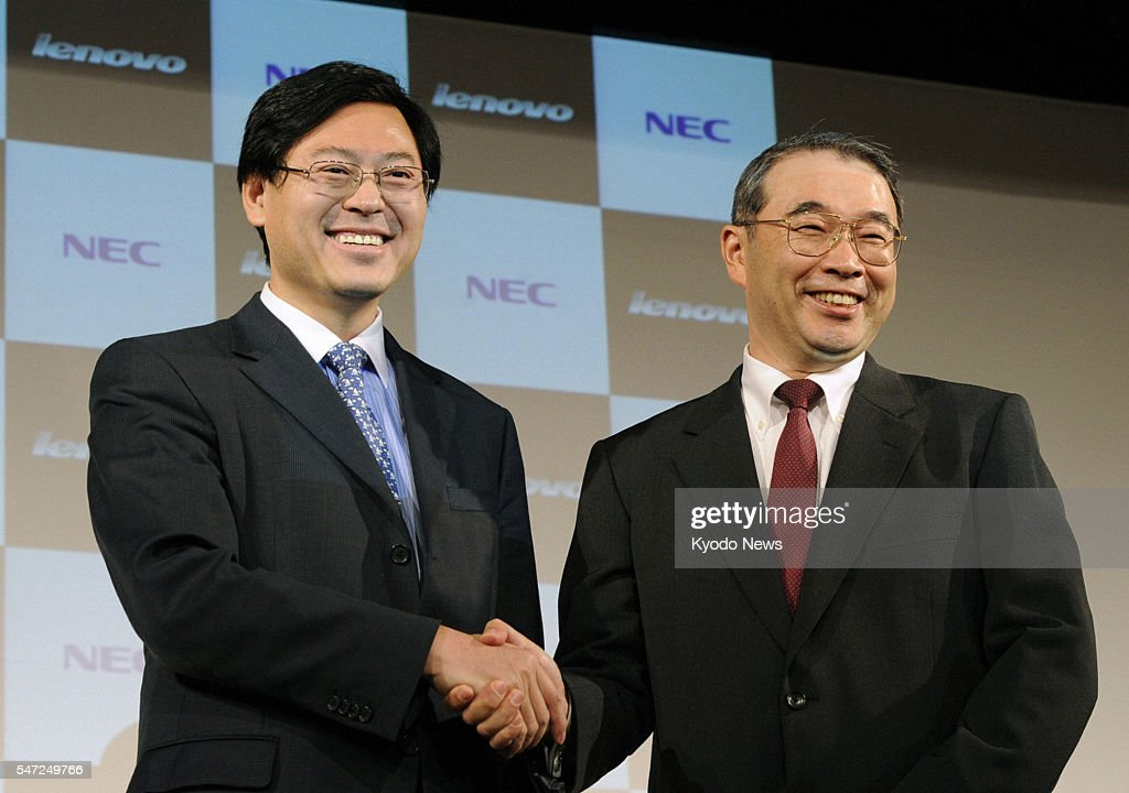 TOKYO Japan Japan's NEC Corp President Nobuhiro Endo and Yang Yuanqing CEO of China's Lenovo Group Ltd shake hands in Tokyo on Jan 27 before a press...