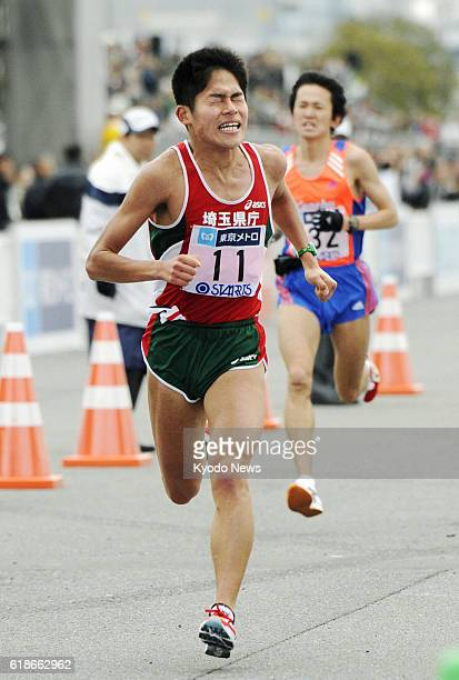 TOKYO Japan Japan's Yuki Kawauchi sprints to the finishing line of the Tokyo Marathon at Tokyo Big Sight in the Japanese capital on Feb 26 2012...