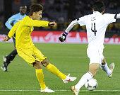 YOKOHAMA Japan Junya Tanaka of JLeague champions Kashiwa Reysol takes a shot in the first half of the Club World Cup thirdplace match against Qatar's...