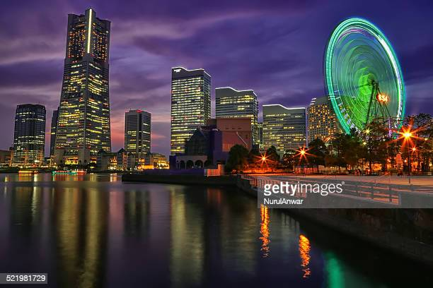 Japan, Kanagawa Prefecture, Yokohama, Illuminated cityscape with Ferris wheel