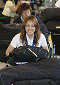 NARITA Japan Karina Maruyama a forward for Japan's women's national soccer team followed by goalkeeper Ayumi Kaihori responds to waiting fans at...