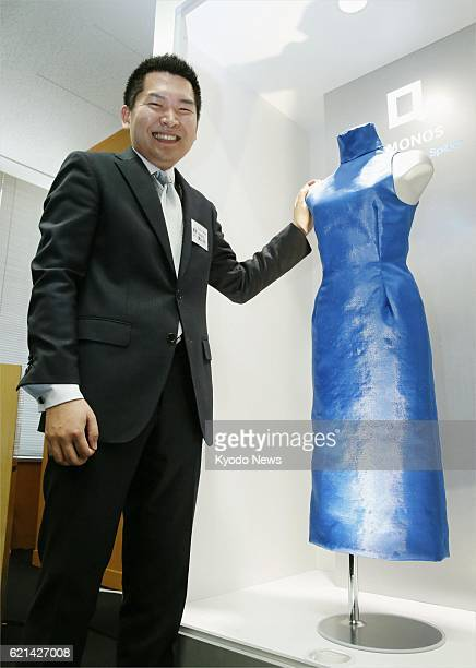 TOKYO Japan Kazuhide Sekiyama president of bioventure Spiber Inc stands in Tokyo on May 24 by a dress made by his company on a trial basis from...