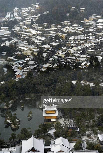 KYOTO Japan Kinkakuji or the Golden Pavilion a Zen Buddhist temple in Kyoto western Japan is dusted with snow in this photo taken from a Kyodo News...