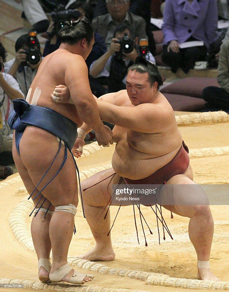 FUKUOKA Japan Kisenosato pushes Homasho out of the ring at Fukuoka Kokusai Center in Fukuoka southwestern Japan on Nov 16 during the Kyushu Grand...
