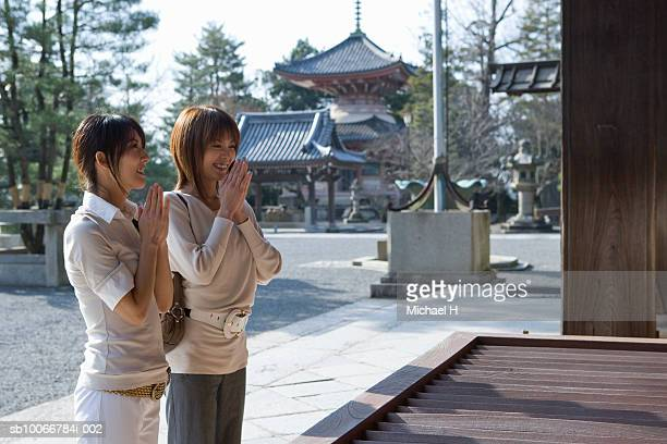 Japan, Kyoto, Chion-In, two women praying in temple