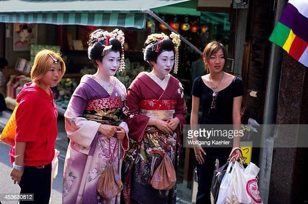 Japan Kyoto Gion District Geisha In Kimono Posing With People