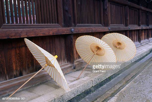 Japan, Kyoto, paper umbrellas drying under Buddhist temple