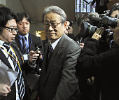 TOKYO Japan Kyoto University President Hiroshi Matsumoto is surrounded by media members after attending a general conference of the Japan Association...