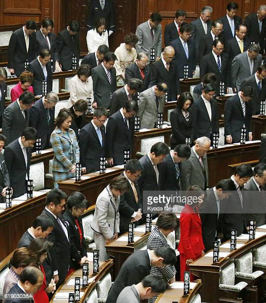 TOKYO Japan Lawmakers observe a moment of silence to pay tribute to the victims of a hostage crisis in Algeria at the main hall of the House of...
