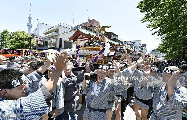 TOKYO Japan Local people carry a mikoshi through the Nakamise Dori shopping street in Tokyo's Asakusa district on May 17 the second day of the annual...