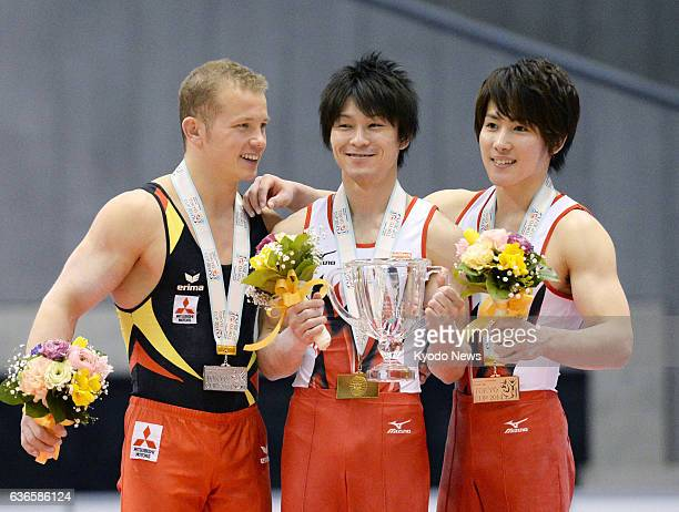 TOKYO Japan London Olympics champion Kohei Uchimura winner of the Tokyo World Cup gymnastics competition is flanked by German runnerup Fabian...