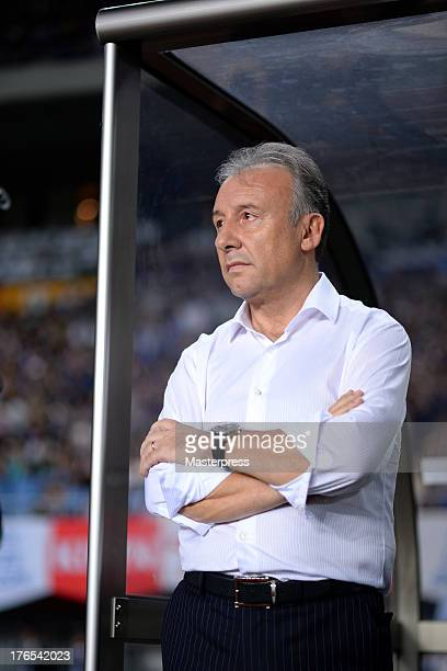 Japan manager Alberto Zaccheroni looks on prior to the international friendly match between Japan and Uruguay at Miyagi Stadium on August 14 2013 in...