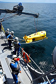 Japan Maritime SelfDefense Force personnel dispatch a camerainstalled minedetecting submersible robot from the minesweeper Enoshima during a JapanUS...