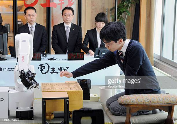 OSAKA Japan Masayuki Toyoshima a professional player of shogi or Japanese chess plays against the computer program 'YSS' in Osaka on March 29 with an...