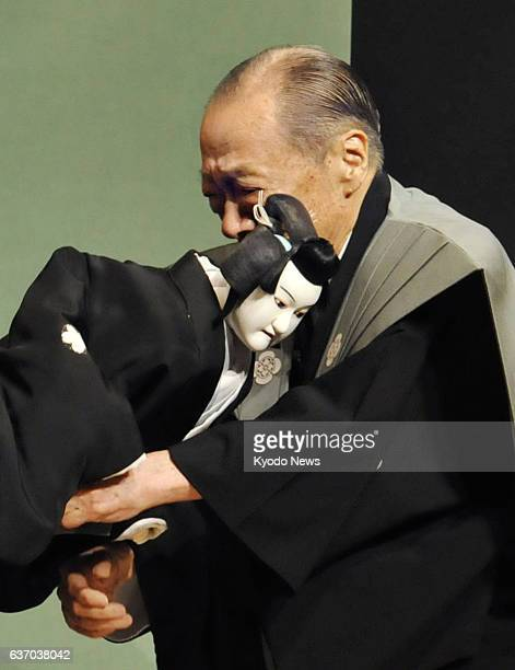 OSAKA Japan Master 'Joruri' narrative music chanter Takemoto Sumidayu hugs a puppet in tears after the 89yearold performer's final stage appearance...