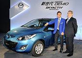 HIROSHIMA Japan Mazda Motor Corp President Takashi Yamanouchi and Inter Milan defender Yuto Nagatomo stand beside the latest model of the automaker's...