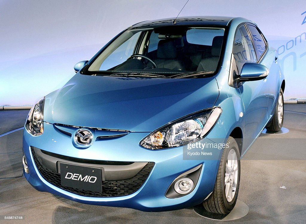 HIROSHIMA Japan Mazda Motor Corp releases the latest model of its mainstay Demio compact car at the company's head office in Hiroshima on June 9 2011...
