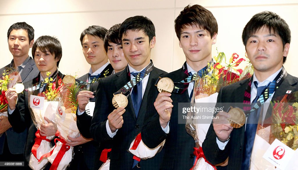 Japan Men's Gymnastics team head coahc Hisashi Mizutori, <a gi-track='captionPersonalityLinkClicked' href=/galleries/search?phrase=Ryohei+Kato&family=editorial&specificpeople=9111024 ng-click='$event.stopPropagation()'>Ryohei Kato</a>, <a gi-track='captionPersonalityLinkClicked' href=/galleries/search?phrase=Kohei+Uchimura&family=editorial&specificpeople=5481263 ng-click='$event.stopPropagation()'>Kohei Uchimura</a>, Yusuke Tanaka, <a gi-track='captionPersonalityLinkClicked' href=/galleries/search?phrase=Ryohei+Kato&family=editorial&specificpeople=9111024 ng-click='$event.stopPropagation()'>Ryohei Kato</a>, Kenzo Shirai, <a gi-track='captionPersonalityLinkClicked' href=/galleries/search?phrase=Naoto+Hayasaka&family=editorial&specificpeople=13713206 ng-click='$event.stopPropagation()'>Naoto Hayasaka</a> and <a gi-track='captionPersonalityLinkClicked' href=/galleries/search?phrase=Koji+Yamamuro&family=editorial&specificpeople=5608587 ng-click='$event.stopPropagation()'>Koji Yamamuro</a> are seen on arrival at Haneda International Airport on November 3, 2015 in Tokyo, Japan.