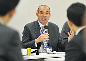 TOKYO Japan Michael Woodford former president and chief executive officer of Olympus Corp attends a meeting of ruling Democratic Party of Japan...