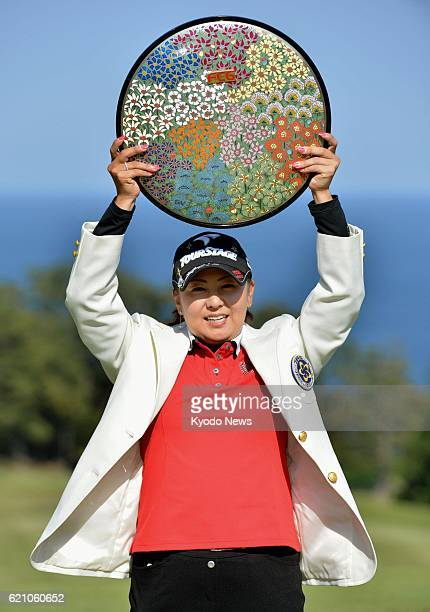 ITO Japan Miki Saiki raises the victory plate after capturing her second JLPGA title in a row at the Fujisankei Ladies Classic at Kawana Hotel Golf...