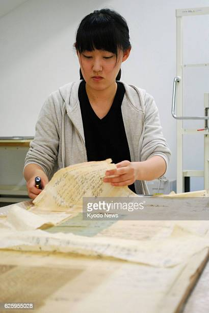 TOKYO Japan Misaki Tanahashi a firstyear graduate student at the Tohoku University of Art and Design restores documents kept by a family in...
