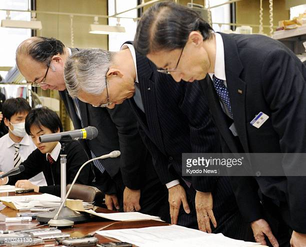 TOKYO Japan Mizuho Bank President Satoru Nishibori and other bank executives bow in apology after a press conference at the head office of the Bank...