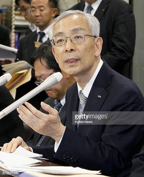 TOKYO Japan Mizuho Bank President Satoru Nishibori speaks in a press conference in Tokyo on March 25 2011 Nishibori said the bank's glitchhit...