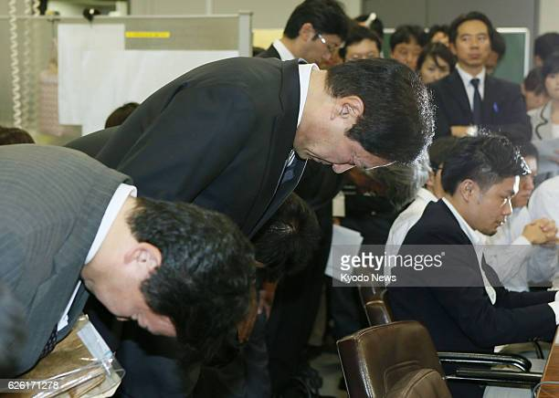 TOKYO Japan Mizuho Bank President Yasuhiro Sato bows during a press conference in Tokyo on Oct 8 2013 Sato said that former President Satoru...