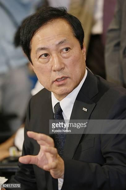 TOKYO Japan Mizuho Bank President Yasuhiro Sato holds a press conference in Tokyo on Oct 8 2013 Sato said that former President Satoru Nishibori had...