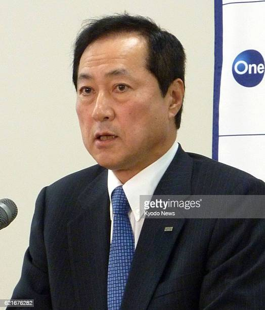 TOKYO Japan Mizuho Bank President Yasuhiro Sato tells a press conference in Tokyo on July 1 that his bank may consider merging with Mizuho Trust...