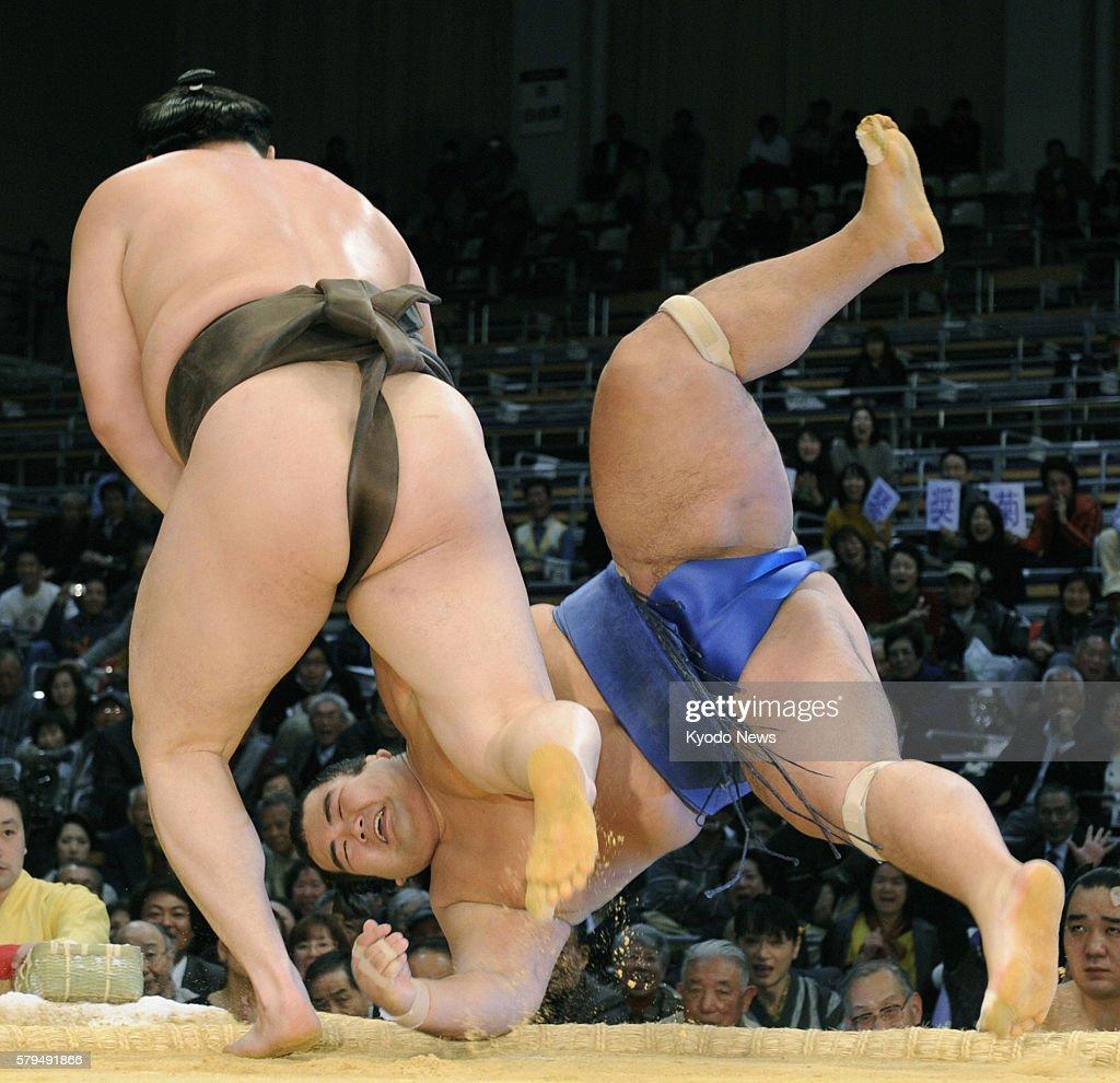 FUKUOKA Japan Mongolian grand champion Hakuho throws ozeki Kotoshogiku during the Kyushu Grand Sumo Tournament at Fukuoka Kokusai Center in Fukuoka...
