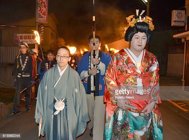 YAMAGATA Japan 'Mujina no mukasari' a traditional event in which a young man dressed up as a bride and a young woman as a groom parade through a...
