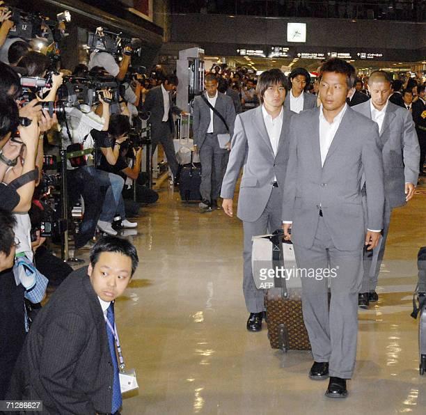Japan national football team foward player Atsushi Yanagisawa and his teammates return at Narita Airporteast of Tokyo 24 June 2006 after their World...