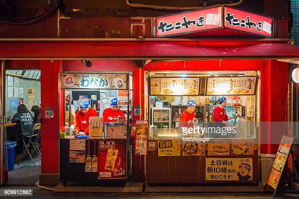 Japan nightlife illuminated workers at fast food stall Osaka