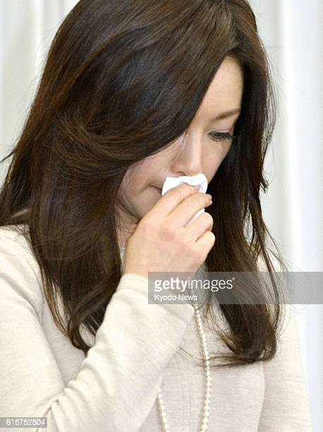 TOKYO Japan Noriko Sakai puts a handkerchief to her mouth at a press conference in Tokyo's Koto Ward on Nov 24 where she announced her return to the...