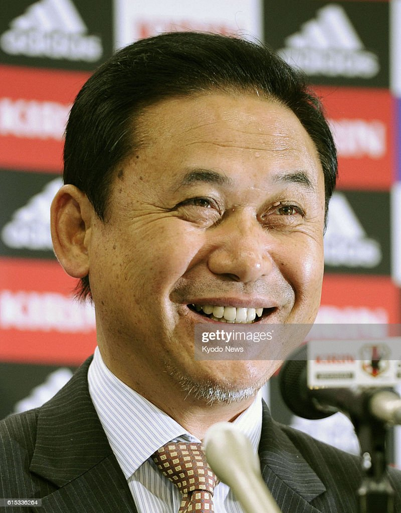 TOKYO, Japan - Norio Sasaki, who guided Japan to a remarkable victory at the 2011 Women's World Cup soccer final and the silver medal at the 2012 London Olympics, smiles at a press conference in Tokyo's Bunkyo Ward on Nov. 1, 2012. The 54-year-old Sasaki will continue as Nadeshiko coach, the Japan Football Association said the same day.