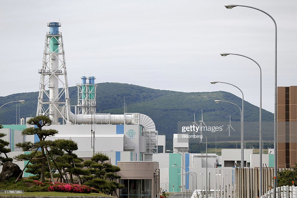 Japan Nuclear Fuel Ltd.'s (JNFL) Rokkasho reprocessing plant stands in Rokkasho Village, Aomori Prefecture, Japan, on Sunday, June 26, 2011. At Rokkasho Village, where a nuclear fuel reprocessing plant and a MOX fuel fabrication facility are under construction, about 60 percent of the jobs are directly related to the nuclear industry whether construction workers or cleaners, cooks or engineers. Photographer: Kiyoshi Ota/Bloomberg via Getty Images
