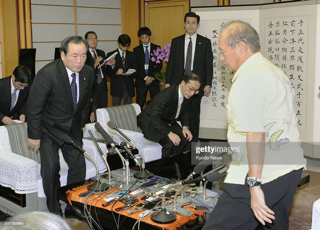 NAHA Japan Okinawa Gov Hirokazu Nakaima stands up to terminate a meeting with Japanese Defense Minister Yasuo Ichikawa at the prefectural government...